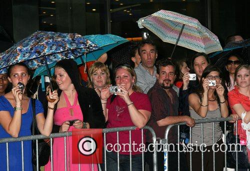 Fans wait in the rain US premiere of...