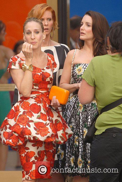 Sarah Jessica Parker and Kristin Davis look on...
