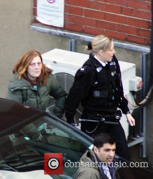 Is led into Wakefield Police Station by a...