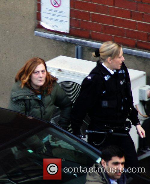 Karen Matthews is led into Wakefield Police Station...