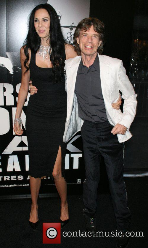 L'Wren Scott and Mick Jagger of the Rolling...