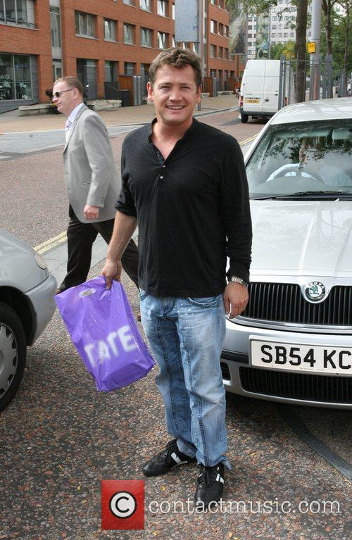 Leaves the ITV studios after appearing on 'This...