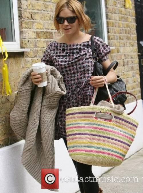 Sienna Miller arriving home after spending the night...
