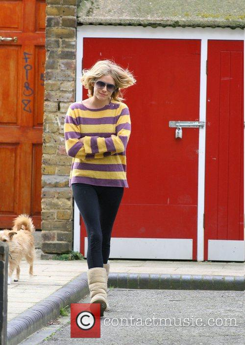 Sienna Miller takes her dogs out London, England