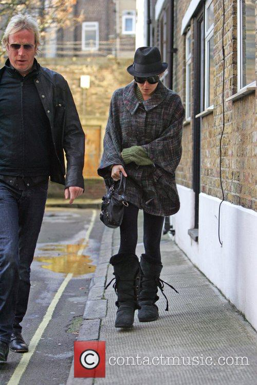 Rhys Ifans and Sienna Miller leave home together....