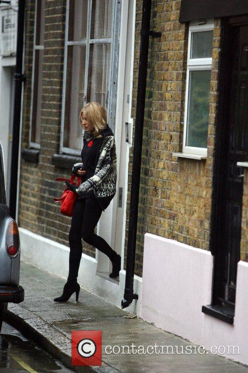Sienna Miller getting into a waiting taxi outside...