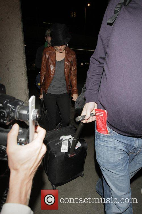Sienna Miller lands at LAX International airport and...