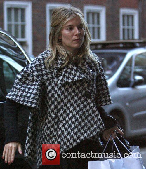 Sienna Miller leaves her London home to visit...