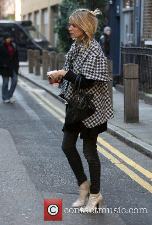 Sienna Miller leaving a health club which is...