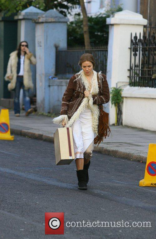 Sienna Miller dressed in vintage clothes and filming...