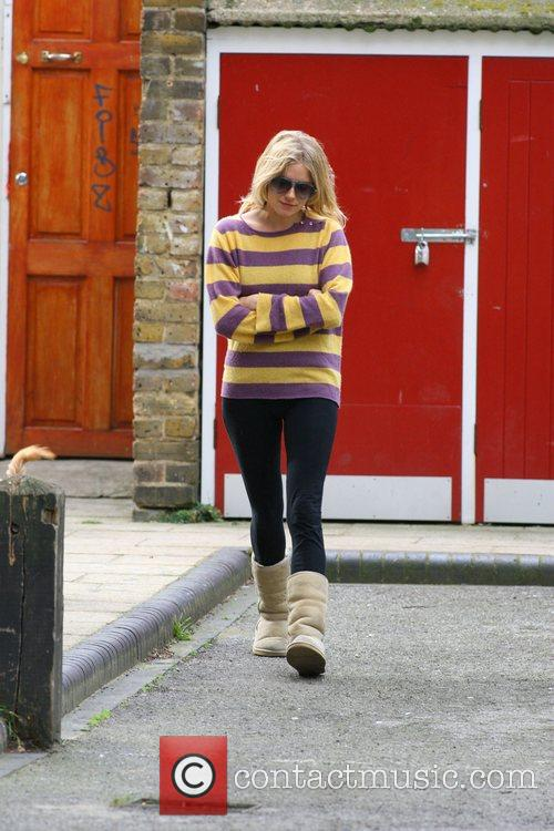 Sienna Miller takes her dogs out