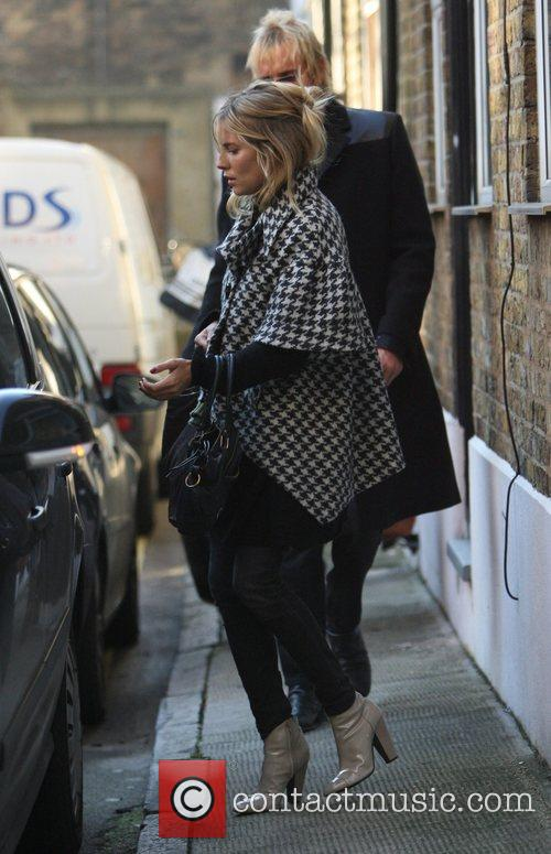 Sienna Miller and Rhys Ifans leave the actress'...