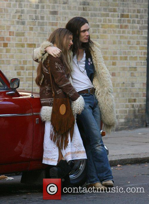 Sienna Miller and Cillian Murphy dressed in vintage...