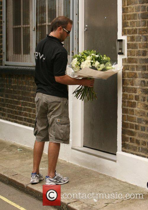 A florist arrives at Sienna Miller's house to...