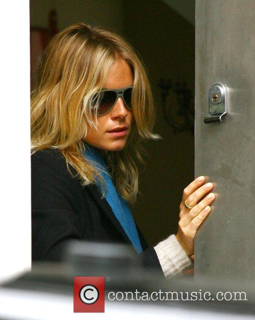 Sienna Miller leaves her house and heads off...