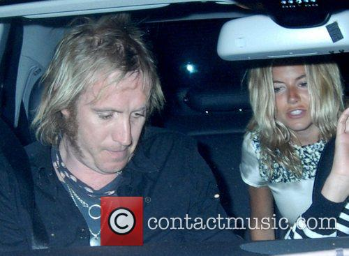Rhys Ifans and Sienna Miller leaving Nobu with...