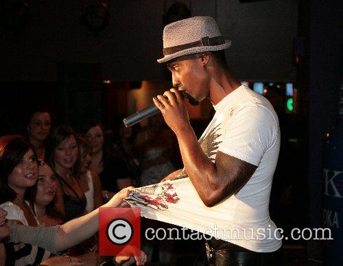 Simon Webbe performing live at the opening of...