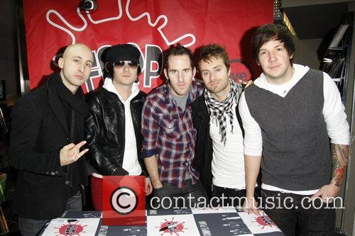 Simple plan at an autograph signing session for...