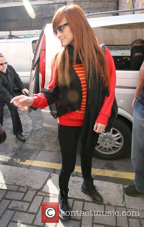 Ashlee Simpson arriving at the Riverside Studios, stops...