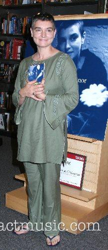 Sinead O'Connor signs copies of her new CD...