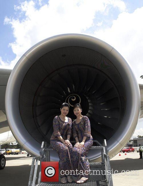 Singapore Airlines flight attendants pose in front of...