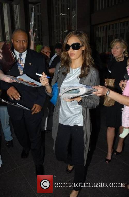 Jessica Alba signs autographs with a pen that...