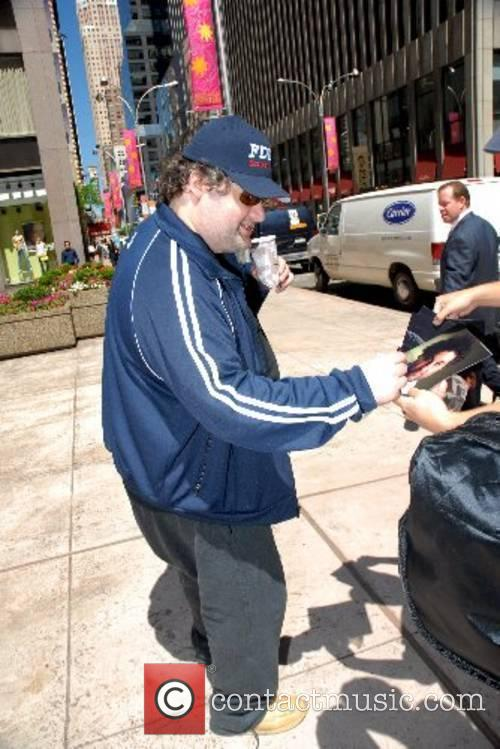 Artie Lange signs an autograph as he leaves...