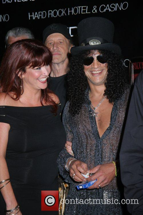 Slash and iconic rock photographer Robert Knight are...