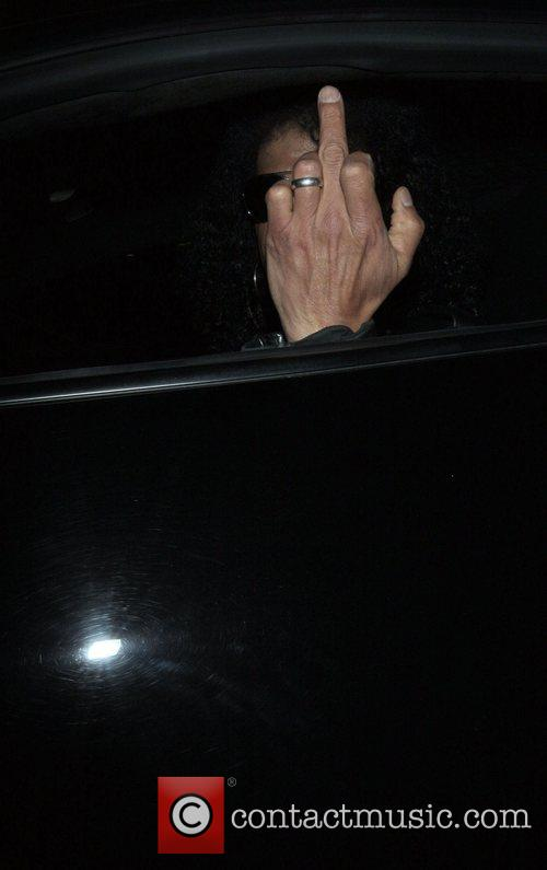 Slash gives the middle finger to photographers as...