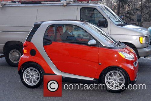 A 'Smart' Fortwo Passion coupe driving on Central...