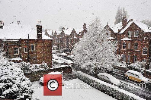 Londoners enjoy a sudden snow-fall on Primrose Hill...