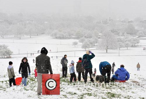 Londoners enjoy a sudden snow-fall on Primrose Hill...