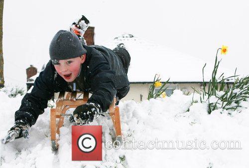 8 year old George enjoying the snow surrey,...