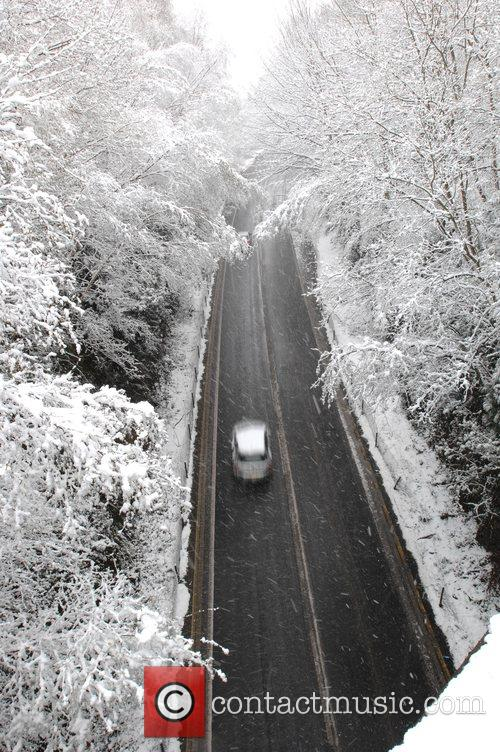 Cars pass on a clear road in East...