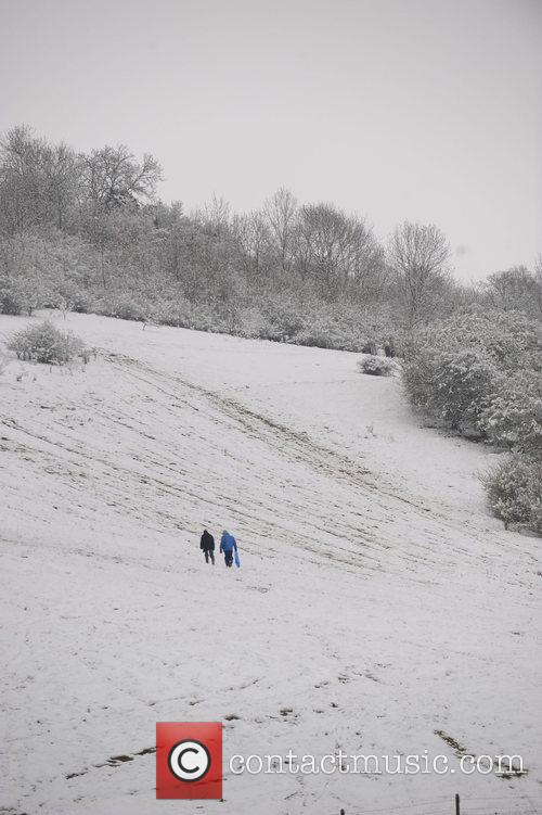 Kids playing in the snow on the South...