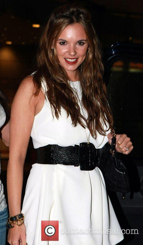Jodi Albert arrives at her hotel after the...