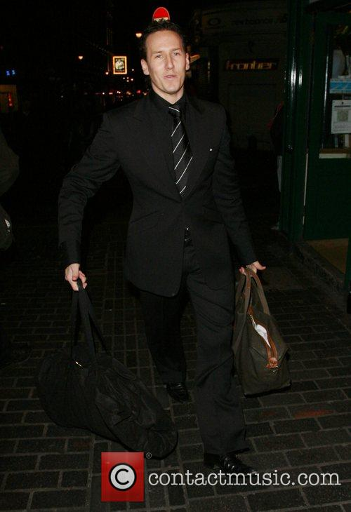 Brendan Cole carrying two huge bags. He asked...