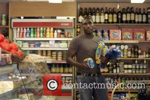 Sol Campbell stocks up on groceries at a...