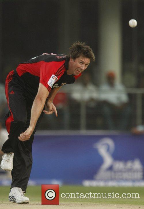 Glenn McGrath bowler of Delhi Daredevils blows during...