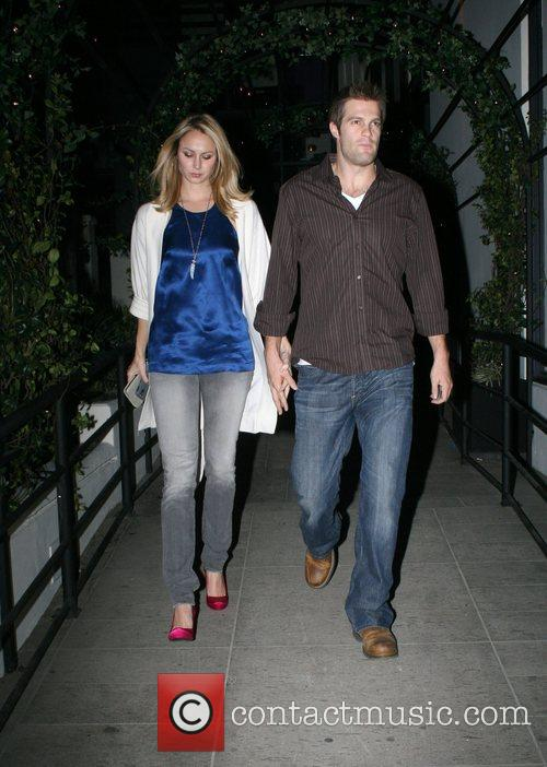 Stacy Keibler and Geoff Stults leaving the new...