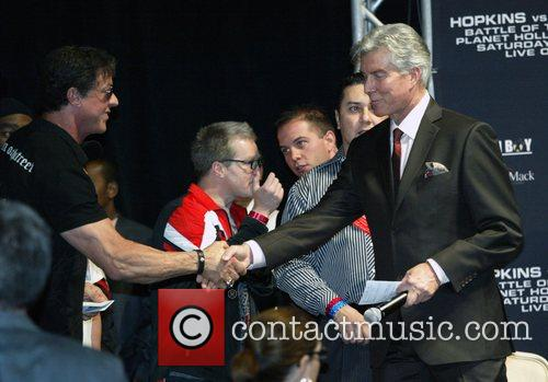 Sylvester Stallone shakes the ring announcer Michael Buffer's...