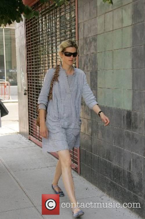 Stella Tenant walking through SoHo