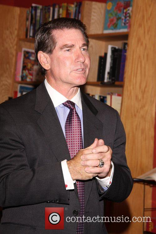 Former Dodgers star Steve Garvey signs his new...