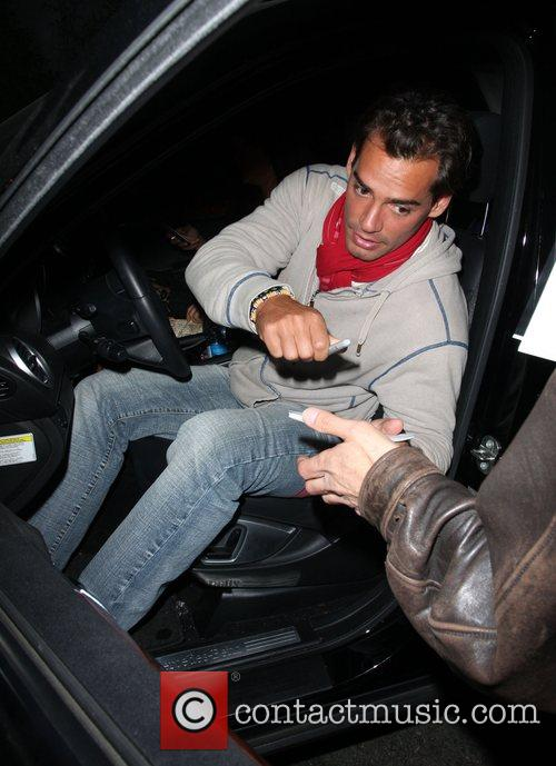 Cristian De La Fuente signing an autograph as...