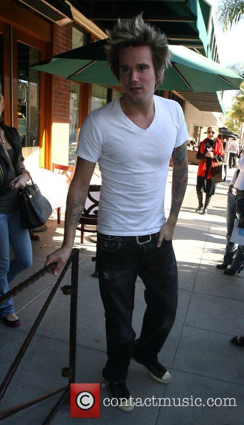 Sean Stuart out and about wearing t-shirt and...