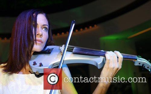 Linzi Stoppard performing on the violin Salon Prive...
