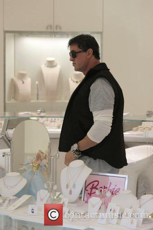 Sylvester Stallone walking around Beverly Hills where he...