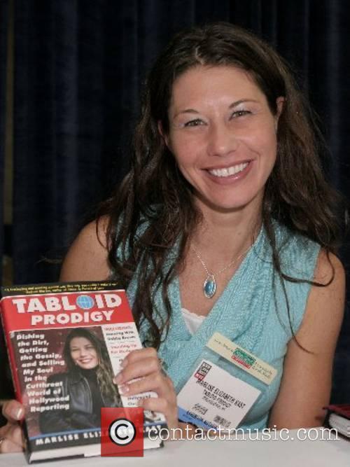 Marlise Elizabeth Kast signs copies of her book...