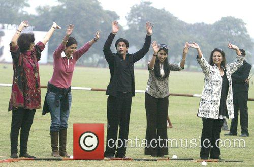Bollywood actor Shahrukh Khan, exercises with Delhi's socialites...