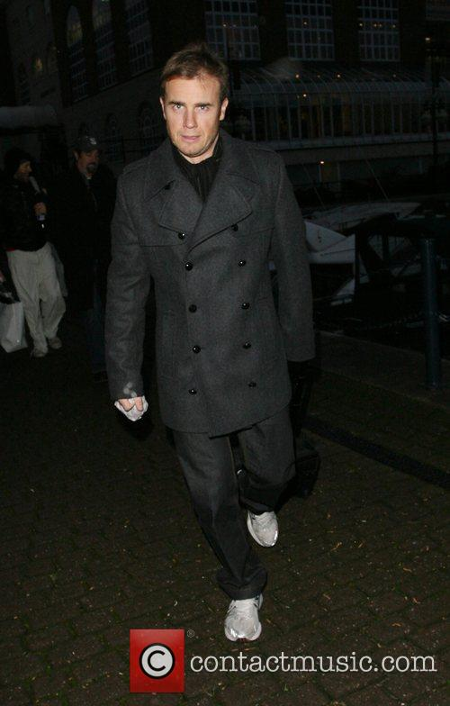 Gary Barlow of boyband Take That carrying a...